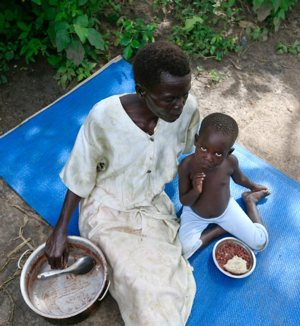 A refugee family from South Sudan eats a meal in 2017 at a settlement camp in Moyo, northern Uganda.