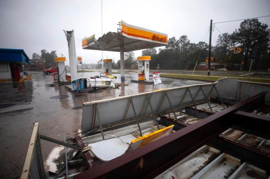 The awning of a Shell gas station is seen partially torn off Sept. 14 after Hurricane Florence came ashore in Wilmington, N.C. The powerful storm is poised to affect more than 10 million people in the southeastern U.S. CNS photo/Jim Lo Scalzo, EPA