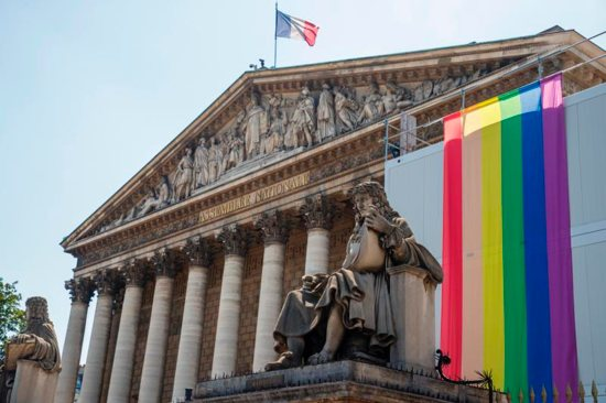 The LGBT rainbow flag is displayed on the facade of the National Assembly in Paris.