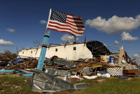 A U.S. flag is seen amid rubble Oct. 11 after Hurricane Michael swept through Panama City, Fla.