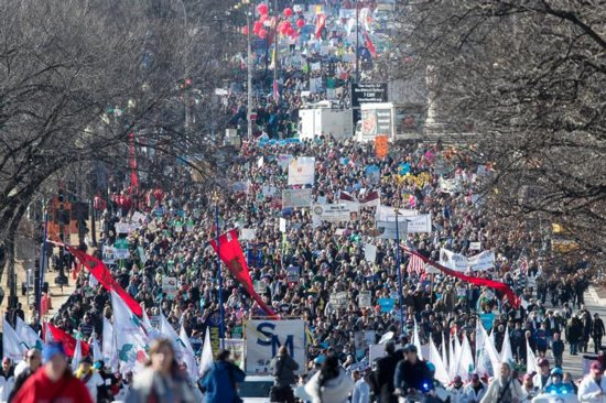 People walk up Constitution Avenue headed toward the U.S. Supreme Court while participating in the 45th March for Life Jan. 19 in Washington.