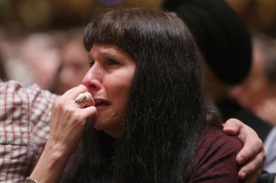 A woman cries during a memorial service at the Sailors and Soldiers Memorial Hall of the University of Pittsburgh Oct. 28, a day after a deadly shooting the Tree of Life Synagogue in Pittsburgh. At least 11 people were killed and six others wounded, including four police officers, during the Oct. 27 shooting at the synagogue.