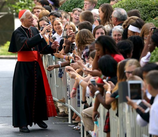 Washington Cardinal Donald Wuerl greets people during Pope Francis' 2015 visit to the United States. The pope has accepted the resignation of Cardinal Wuerl as archbishop of Washington but did not name a successor.
