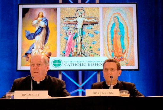 Bishop Robert P. Deeley of Portland, Maine, and Auxiliary Bishop Andrew H. Cozzens of St. Paul and Minneapolis attend a news conference Nov. 13 at the fall general assembly of the U.S. Conference of Catholic Bishops in Baltimore.