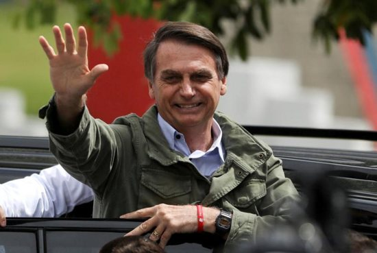Newly elected Brazilian President Jair Bolsonaro, a Catholic, waves Oct. 28 at a polling station in Rio de Janeiro.