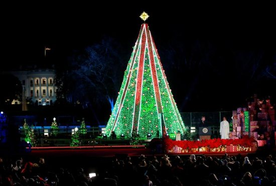 U.S. President Donald Trump and first lady Melania Trump participate in the 96th annual National Christmas Tree Lighting ceremony near the White House in Washington.