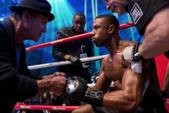 """Sylvester Stallone, Wood Harris, Michael B. Jordan and Jacob Duran star in a scene from the movie """"Creed II."""" The Catholic News Service classification is A-III -- adults. The Motion Picture Association of America rating is PG-13 -- parents strongly cautioned. Some material may be inappropriate for children under 13."""