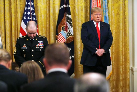 U.S. President Donald Trump prays alongside former U.S. Army medic Ronald J. Shurer during a Medal of Honor ceremony Oct. 1 at the White House in Washington. Shurer, a parishioner at the Church of the Nativity in Burke, Va., was presented the Medal of Honor for actions he took while serving in 2008 in Afghanistan