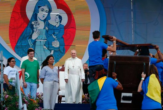 Pope Francis watches as young people carry the World Youth Day cross and icon during a welcoming ceremony and gathering with young people in Santa Maria la Antigua Field in Panama City Jan. 24, 2019.