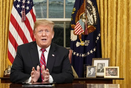 U.S. President Donald Trump delivers an address Jan. 8 televised to the nation from his desk in the Oval Office at the White House in Washington. He spoke about immigration and the southern U.S. border on the 18th day of a partial government shutdown.