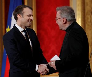 French President Emmanuel Macron greets Italian Archbishop Luigi Ventura as he presents his New Year wishes to members of the diplomatic corps at the Elysee Palace in Paris Jan. 4, 2018. Archbishop Ventura, 74, a Vatican diplomat who once served in Canada, Chile and western Africa, is under investigation by police in Paris for allegedly sexually assaulting a city official.