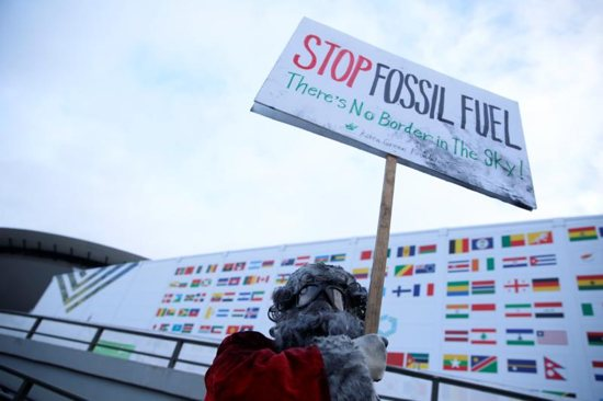 Environmental activist protests against fossil fuel outside the COP24 U.N. Climate Change Conference in Katowice, Poland, Dec. 10, 2018. The Austrian bishops' conference said March 22 it would divest from fossil fuels within five years.