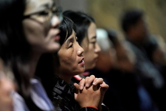The faithful attend Mass at Beijing's South Catholic Church Sept. 29, 2018. In a new book, the Vatican secretary of state, Cardinal Pietro Parolin, writes that the Vatican's recent agreement with the Chinese government was motivated by a desire to spread the Gospel and assure freedom of the church.