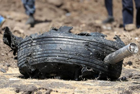 A tire of the Ethiopian Airlines Flight ET 302 is seen March 11, 2019, near Bishoftu, Ethiopia. The crash killed 157 people from 35 countries. Among the dead were Georgetown University law student Cedric Asiavugwa and four Catholic Relief Services staffers: Getnet Alemayehu, Mulusew Alemu, Sintayehu Aymeku and Sara Chalachew.