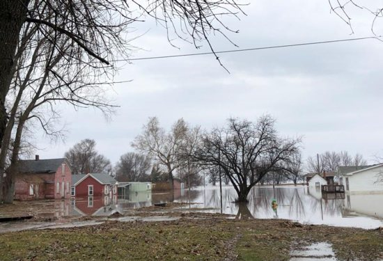 "Floodwaters surround homes in Peru, Neb. March 19, 2019. Nebraska Gov. Pete Ricketts and the state's National Guard surveyed flooded farms, homes, bridges and highways, damage Ricketts called ""devastating"" and perhaps the worst in a half-century. At least three people have been reported killed."