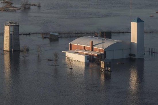 "The flooded facility of the Camp Ashland Army National Guard in Ashland, Neb., is seen in this aerial photo March 17, 2019. Nebraska Gov. Pete Ricketts and the state's National Guard surveyed flooded farms, homes, bridges and highways, damage Ricketts called ""devastating"" and perhaps the worst in a half-century. At least three people have been reported killed. CNS photo/Herschel Talley, Nebraska National Guard handout via Reuters"
