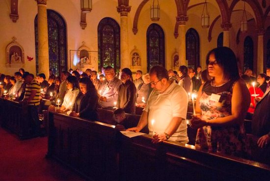Catechumens and others attend the Easter Vigil Mass in 2016 at St. Paul Church in Wilmington, Del. The U.S. church welcomes thousands of new Catholics at Easter Vigil Masses March 31.