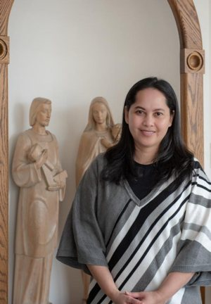 Phally Budock, a survivor of the Cambodian genocide, will enter the Catholic Church during the Easter Vigil at St. Andrew the Apostle Church in Silver Spring, Md. She is pictured in a March 13, 2019, photo.