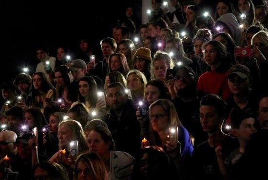 """People hold up lights from their cellphones during a vigil May 8, 2019, for victims of a shooting at the STEM School Highlands Ranch in Colorado. Catholic leaders are calling for prayer and action in response to the May 7 shooting inside the charter school near Denver that focuses on science, technology, engineering and math. Kendrick Castillo, an 18-year-old Catholic senior was killed when he """"lunged"""" at one of the shooters to save others. Eight other students were wounded."""