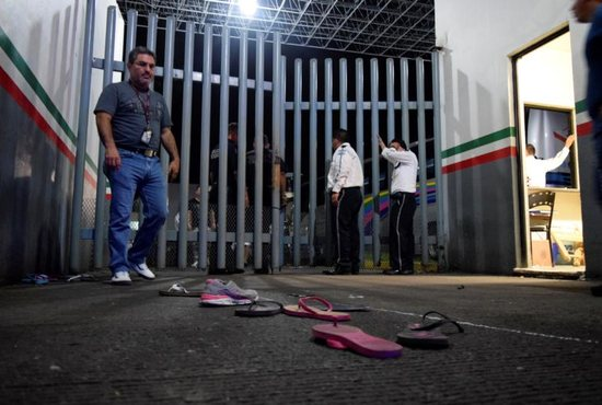 Private security guards in Tapachula, Mexico, are seen at an immigrant detention center where migrants broke out and escaped April 25, 2019. The Mexican bishops' conference appealed assistance for thousands of migrants stuck in Chiapas state as Mexican officials stepped up enforcement and stopped issuing travel documents.