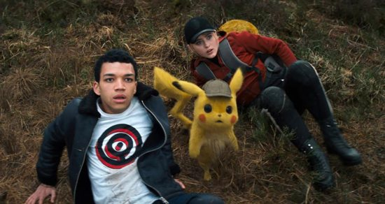 """Justice Smith, Detective Pikachu, voiced by Ryan Reynolds, and Katrhyn Newton appear in the movie """"Pokemon Detective Pikachu."""" The Catholic News Service classification is A-II -- adults and adolescents. The Motion Picture Association of America rating is PG -- parental guidance suggested. Some material may not be suitable for children."""