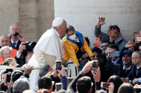 Pope Francis kisses a child during his general audience in St. Peter's Square at the Vatican May 8, 2019.