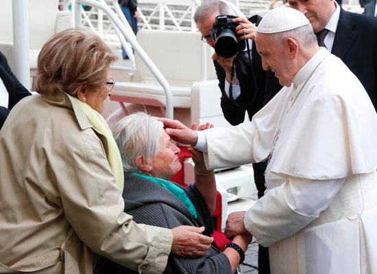 Pope Francis blesses a woman in a wheelchair during his general audience in St. Peter's Square at the Vatican May 29, 2019.