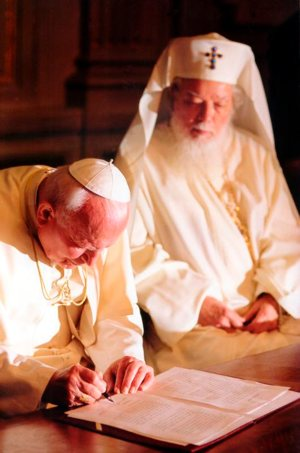 Pope John Paul II and Romanian Orthodox Patriarch Teoctist sign a joint appeal for brotherhood and coexistence in the Balkans, in Bucharest, Romania, in May 1999. The trip was a significant step toward improved relations between the Orthodox majority and the Catholic minority in Romania.