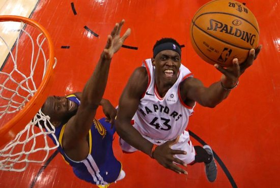 Toronto Raptors forward Pascal Siakam (43) shoots the ball against Golden State Warriors forward Draymond Green (23) in game one of the 2019 NBA Finals at Scotiabank Arena in Toronto May 30, 2019.