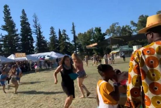 People run as an active shooter is reported at the Gilroy Garlic Festival in California