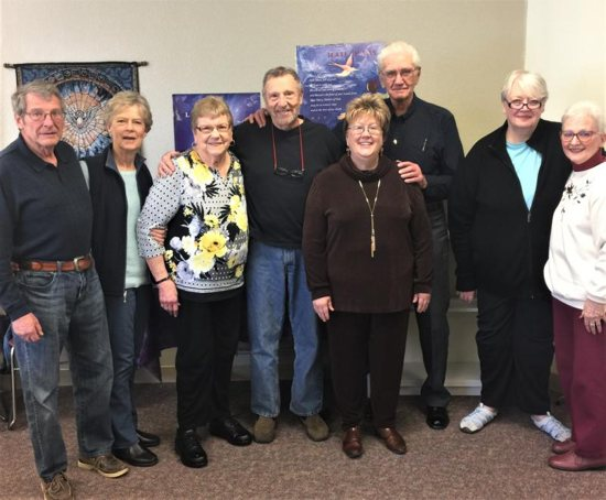 Rita Hill, in yellow blouse, poses for a photo April 9, 2019, with other Landings returnees.