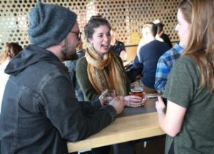 Catholic young adults gather at Able Seedhouse and Brewery in Northeast for a Catholic Beer Club