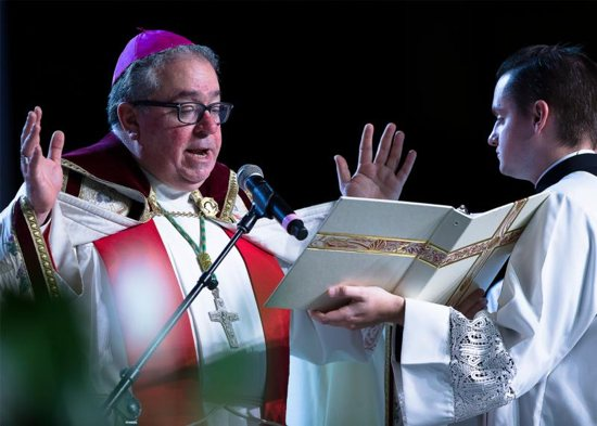 Bishop Michael Olson of Fort Worth, Texas, leads the morning prayer