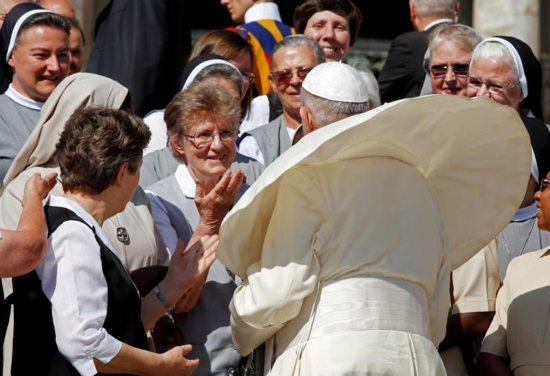 Pope Francis greets pilgrims during his general audience