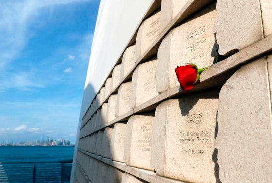 A red rose is seen on a ledge of the Sept. 11 Memorial