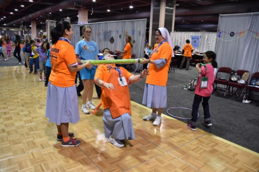 A playful moment at the Youth Congress with IHM sisters. (Sun photo | Katherine Long)