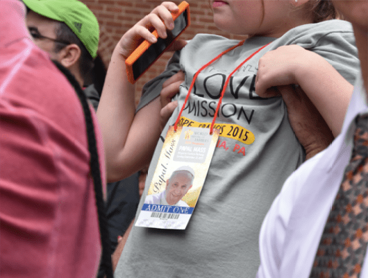 Small pilgrim held aloft by dad while waiting in line for Mass Sept. 27. (Sun photo | Katherine Long)