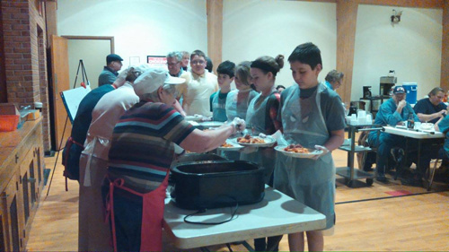 The seventh and eighth grade students from Holy Family School in Norwich delivered donations to the soup kitchen held at St. Bartholomew's Church and helped to serve a meal there.