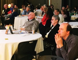 The crowd participating in the New Evangelization Summit April 16 is riveted by Sherry Weddell's presentation on parish renewal.