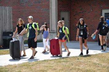 Pilgrims make their way to the bus. (Sun photo | Katherine Long)