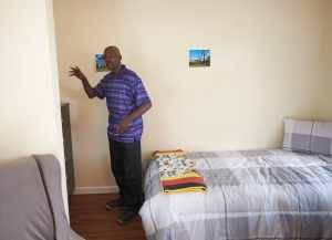 Dolphus Johnson offers a tour of his new home July 22. (Sun photo | Chuck Wainwright)