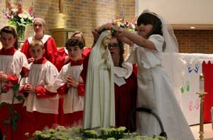 St. Daniel Church in Syracuse held a combined celebration of First Communion and May Crowning May 6, with the First Communion students crowning Mary. Pictured above is Toni Cosco. -Photo courtesy St. Daniel Church