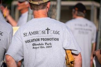 The parishoners of OLGC and St. Ambrose played against the Men In Black Softball team made up of priests and seminarians in Endicott on Sunday.