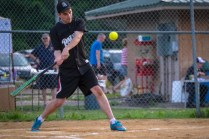 Seminarian Dennis Walker swings during the Men In Black Softball game against the parishoners of OLGC and St. Ambrose in Endicott on Sunday.