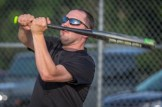 Deacon Matthew Rawson swings during the Men In Black Softball game against the parishoners of OLGC and St. Ambrose in Endicott on Sunday.