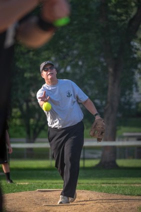 OLGC parishoner Scott Coyal pitches during the Men In Black softball game in Endicott on Sunday.