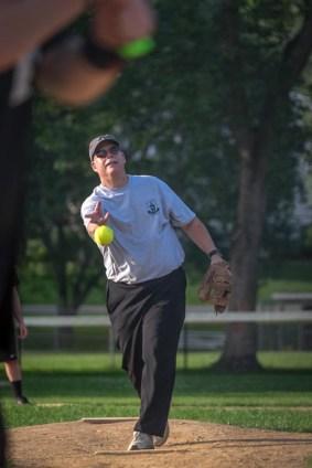 OLGC parishoner Scott Coyal pitches during the Men In Black softball game in Endicott on Sunday.