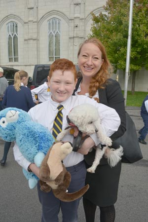 The parking lot of Notre Dame Elementary School in Utica was full of all God's creatures — cats, dogs, hermit crabs, and even a turtle. Following Mass, students had their animals blessed by Father Joe Salerno.