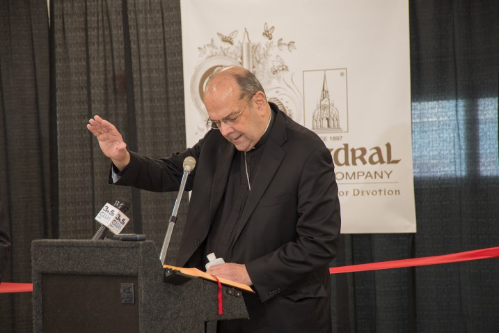 Bishop Robert J. Cunningham blesses the new expansion at Cathedral Candle Company. (Photo courtesy Cathedral Candle Company)
