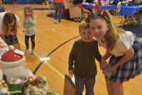 Pre-kindergartner Rory Hill enjoys the shopping with her big sister Emma.